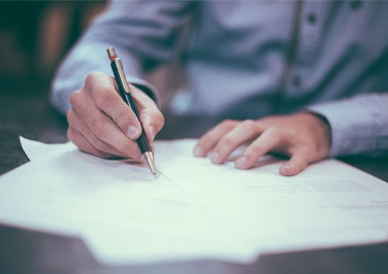 What is an Insolvency Practitioner post, featuring an image of a man's hands writing on a piece of paper